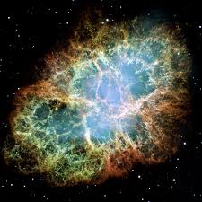 The Crab Nebula, shown here as it is today, is the remnant of a supernova which was seen in the year 1054 AD and remained visible to the naked eye for about a year.  (Credit: NASA)