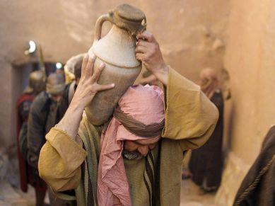 Man Carrying Water Jar